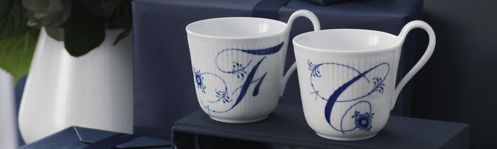 Each hand painted letter on the Alphabet mugs is adorned with a flower and two palmettes.